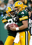 Green Bay's Donald Driver and Brett Favre celebrates Favre's 33-yard touchdown pass to Driver in the 3rd quarter. This gave the Packers a 34-13 lead. . The Green Bay Packers hosted the Dallas Cowboys at Lambeau Field in Green Bay, October 24, 2004. WSJ/Steve Apps.