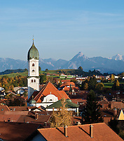 Tower of Saint Andreas Chuch and mountains of Allgaeu region, Nesselwang, Germany