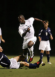 Kyle Helton (above), of Duke, is fouled by Longwood University's Max Griessbach (below), who earned a yellow card for the tackle, on Tuesday September 27th, 2005 at Duke University's Koskinen Stadium in Durham, North Carolina. The Duke University Blue Devils defeated the Longwood University Lancers 3-1 during an NCAA Division I Men's Soccer game.