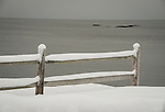 Long Island Sound with split rail fence and fresh snow.