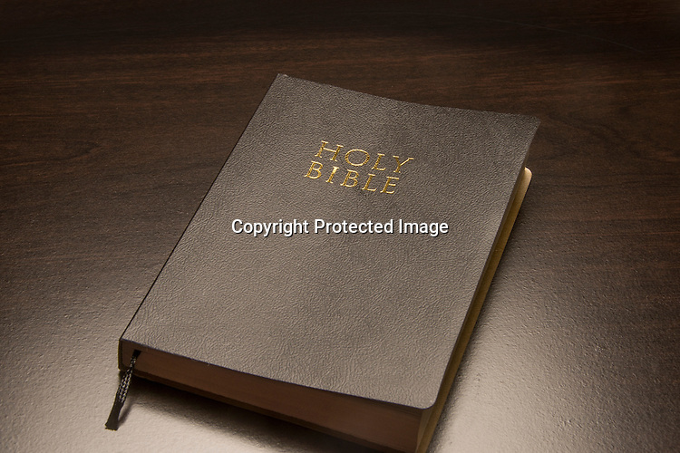 Black Holy Bible on a black surface