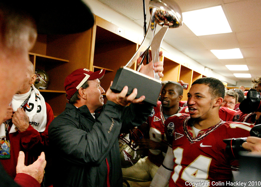 JACKSONVILLE, FL 1/1/10-FSU-WV FB CH89-Florida State Offensive Coordinator Jimbo Fisher hoists the Gator Bowl Trophy after the Seminoles beat the West Virginia Mountaineers 33-21 in the Gator Bowl, Friday in Jacksonville, Fla..COLIN HACKLEY PHOTO