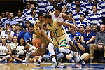 16 January 2016: Notre Dame's Demetrius Jackson (11) and V.J. Beachem (left) strip the ball from Duke's Brandon Ingram (in white). The Duke University Blue Devils hosted the University of Notre Dame Fighting Irish at Cameron Indoor Stadium in Durham, North Carolina in a 2015-16 NCAA Division I Men's Basketball game. Notre Dame won the game 95-91.