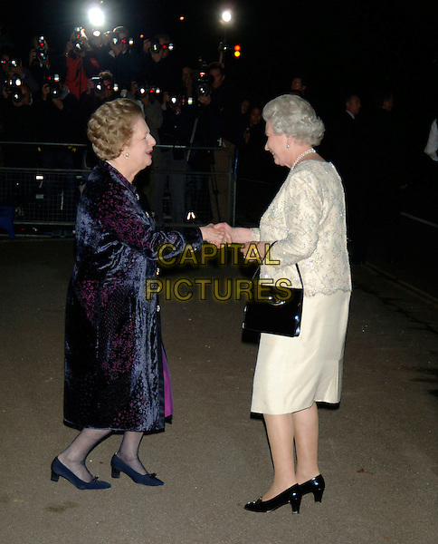 LADY MARGARET THATCHER & HM THE QUEEN ELIZABETH II.80th birthday party for former Prime Minister Margaret Thatcher.Mandarin Oriental Hotel.London, England 13th  October 2005.Ref: PL.full length royal curtsey shaking hands handshake.www.capitalpictures.com.sales@capitalpictures.com.©Capital Pictures