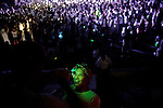 Revelers covered in neon paint, dance the night away at DayGlow, a DJ concert which has become a popular event for teenagers and college student across the country.