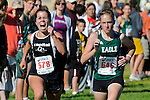 Capital senior Abby Larson and Eagle sophomore Brooke Rawlins	on the straightaway to the finish line during the NNU Invite at West Park in Nampa, ID on September 11, 2010. <br /> <br /> Rawlins finished in 20:49.50 and Larsen in 20:49.90 to finish fifteenth and sixteenth respectively.