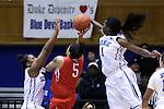 28 November 2014: Duke's Elizabeth Williams (1) blocks a shot by Stony Brook's Kori Bayne-Walker (5). The Duke University Blue Devils hosted the Stony Brook University Seahawks at Cameron Indoor Stadium in Durham, North Carolina in a 2014-15 NCAA Division I Women's Basketball game. Duke won the game 72-42.