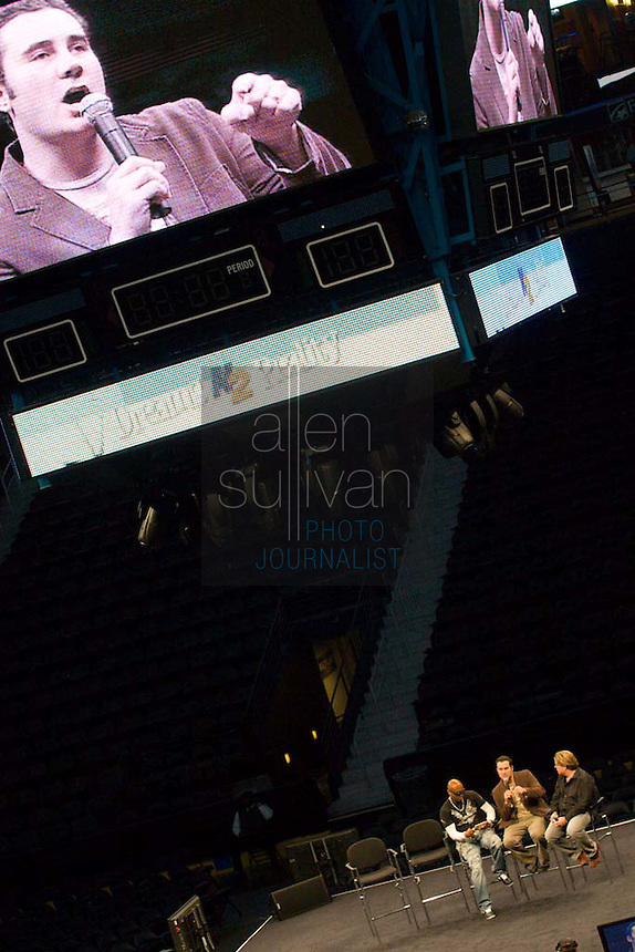 "Casting director Neal Konstantini (on video screen and seated middle) speaks on stage with former ""Real World"" star Syrus (left) and Q100.5's Jeff Dauler during a Dreams N2 Reality show and casting call at Philips Arena in Atlanta on Saturday, August 4, 2007. People offered their auditions in hopes of gaining spots on game shows and others in the reality TV genre."