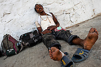 "A Honduran immigrant, wounded by a fall of the train, waits to catch the cargo train called 'La Bestia' (The Beast) on a train station in a border town of Arriaga, Mexico, 24 May 2011. Between 2010 and 2015, the US and Mexico have apprehended almost 1 million illegal immigrants from El Salvador, Honduras, and Guatemala. While the economic reasons remain the most frequent motivation for people from Central America to illegally immigrate to the US, thousands of Salvadorans, Guatemalans, and Hondurans, many of them minors, seek asylum in the US due to the thriving crime and gang-related violence in their region (known as the Northern Triangle). Taking an exhausting and risky journey, riding thousands of miles atop the cargo trains, facing a physical danger and extortion from the organized crime groups that control migrant routes, the ""undocumented"" still flee to the US, looking for their American dream."