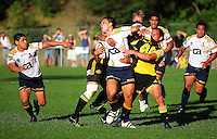 Ma'a Nonu (obscured) and Aaron Cruden tackle Brumbies fullback Matt Toomua during the Super 14 rugby union match between the Hurricanes and Brumbies at Porirua Park, Wellington, New Zealand on Friday 29 January 2010. Photo: Dave Lintott / lintottphoto.co.nz