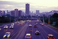 Cars rush by at sunset on H1 freeway near Kapiolani Blvd, Honolulu, Hawaii
