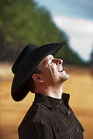 Cowboy with his head back laughing