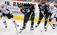 Milwaukee Admirals' Mark Van Guilder battles San Antonio Rampage's Bill Thomas, left, for the puck as Admirals' Kevin Henderson (15) and Rampage's Mark Cullen (17) look on during the first period of an AHL hockey game, Tuesday, April 10, 2012, in San Antonio. (Darren Abate/pressphotointl.com)