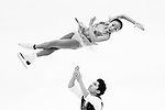 TAIPEI, TAIWAN - JANUARY 22:  (EDITORS NOTE: This images has been converted to black and white)  Wenjing Sui and Cong Han of China compete in the Pairs Short Program event during the Four Continents Figure Skating Championships on January 22, 2014 in Taipei, Taiwan.  Photo by Victor Fraile / Power Sport Images *** Local Caption *** Wenjing Sui; Cong Han