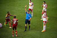 HARRISON, NJ - Wednesday June 24, 2015: Demar Phillips receives a yellow card in the 55th minute.  The New York Red Bulls defeat Real Salt Lake 1-0 at home at Red Bull Arena in regular season MLS play.