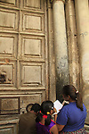 Israel, Jerusalem, pilgrims by the closed door of the Church of the Holy Sepulchre on Holy Thursday