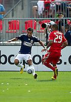07 August 2010: Chivas USA midfielder Rodolfo Espinoza #24 and Toronto FC forward Maicon Santos #29 in action during a game between Chivas USA and Toronto FC at BMO Field in Toronto..Toronto FC won 2-1.