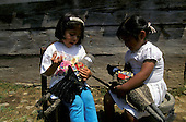 = Children playing  with zapatist dolls (Marcos)  in San Cristobal  Chiapas  Mexico  /// enfants jouant avec des poupées Zapatistes à San Cristobal  Chiapas  Mexique  +