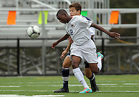 HYATTSVILLE, MD - OCTOBER 26, 2012:  Chris Odoi-Atsem (18) of DeMatha Catholic High School heads the ball in front of Nelson Reed (11) of St. Albans during a match at Heurich Field in Hyattsville, MD. on October 26. DeMatha won 2-0.