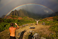 Photographing a moment with a Kalalau Valley double rainbow on the Na Pali Coast of Kauai