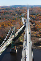 The old and new Penobscot Narrows bridges spanning the Penobscot river in Prospect, Maine
