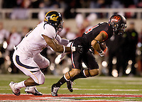 Nick Forbes of California tries to tackle Reggie Dunn of Utah during the game at Rice-Eccles Stadium in Salt Lake City, Utah on October 27th, 2012.   Utah Utes defeated California, 49-27.