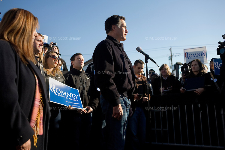 "Republican presidential candidate Mitt Romney, former governor of Massachusetts, speaks to the media during a ""press availability"" after a rally in Manchester, New Hampshire, on Sat. Dec. 3, 2011. The rally was called, ""Earn It with Mitt,"" and was designed to bolster local efforts to help Romney ""earn"" voters' support for the upcoming Republican primary."