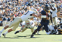 Dasarte Yarnway escapes Tom McConnell. The University of California Berkeley Golden Bears defeated the UC Davis Aggies 52-3 in their home opener at Memorial Stadium in Berkeley, California on September 4th, 2010.