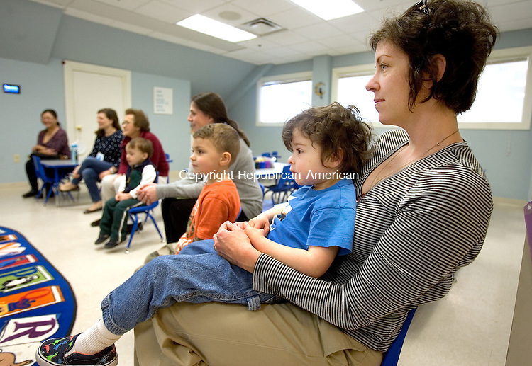 SOUTHBURY CT. 13 April 2015-041315SV02-Neil Juncadella, 2, and his mom Kelly Donahoe of Southbury enjoy a story during drop in story time at the library in Southbury Monday. <br /> Steven Valenti Republican-American