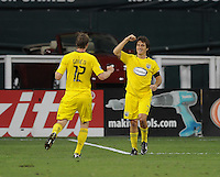 Columbus Crew forward Guillermo Barros Schelotto (7) celebrates his goal in the 23th minute of the match with team mate Eddie Gaven (12).  The Columbus Crew defeated DC united 1-0, at RFK Stadium, Saturday September 4, 2010.