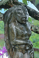 Oviri, a sculpture from 1894 by Gauguin, a cast of which was placed on his grave in 1973, on the tomb of the French artist Paul Gauguin, 1848-1903, in Calvary Cemetery, near Atuona, on the island of Hiva Oa, in the Marquesas Islands, French Polynesia. Gauguin lived in Atuona from 1901, having previously lived on Tahiti for many years. Picture by Manuel Cohen