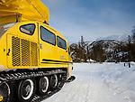 A bombardier snow coach is shown here on its way back to Mammoth Hot Springs from Old Faithful.  In winter, these and other types of track vehicles are the only motorized way to travel most of the park roads as the roads are not plowed, but instead are groomed for track vehicles like these.  Photo by Gus Curtis.