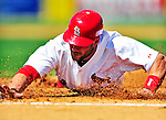 10 March 2010: St. Louis Cardinals' outfielder Skip Schumaker dives safely back to first during a Spring Training game against the Washington Nationals at Roger Dean Stadium in Jupiter, Florida. The Cardinals defeated the Nationals 6-4 in Grapefruit League action. Mandatory Credit: Ed Wolfstein Photo