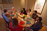SEATTLE, WA-APRIL 17, 2017:  (going from Amanda right and clockwise) Lots of laughter ensued during the dinner party with Amanda Saab, center, Anjana Agarwal, Charissa Pomrehn, Patricia Rangel, Hussein Saab, Stefanie Fox, Greg Pomrehn and Nason Fox. <br /> <br /> Amanda Saab, along with her husband Hussein Saab, host a &quot;dinner with your Muslim neighbor&quot; at the home of Stefanie and Nason (cq) Fox in Seattle, WA on a return trip April 17th 2017. The couple now live in Detroit. (Photo by Meryl Schenker/For The Washington Post)