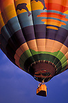 Hot air balloon rising in morning light at the International Balloon Fiesta, Albuquerque, New Mexico USA
