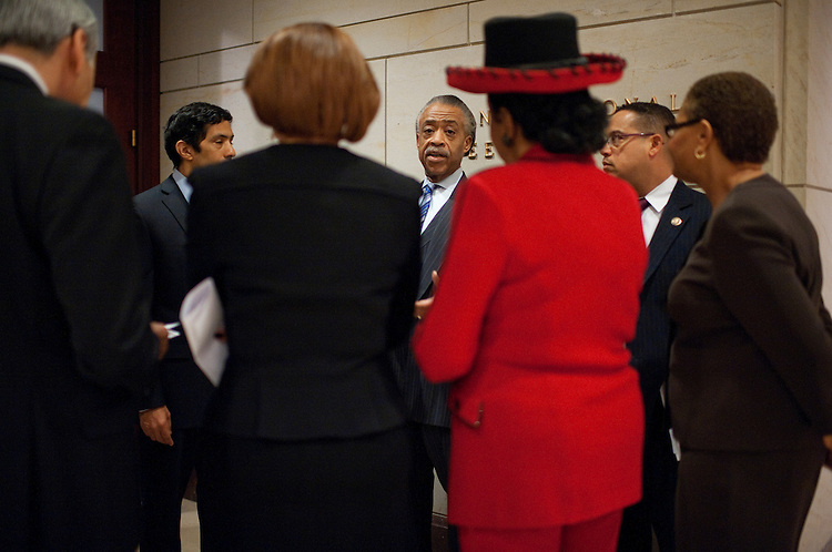 UNITED STATES - FEBRUARY 16:  Rev. Al Sharpton, center, president of National Action Network, briefs, from left, Reps. Charlie Gonzalez, D-Texas, Hansen Clarke, D-Mich., Nydia Velázquez, D-N.Y., Frederica Wilson, D-Fla., Keith Ellison, D-Minn., and Karen Bass, D-Calif., before a news conference in the Capitol Visitor Center on voter suppression and the upcoming march from Selma to Montgomery to commemorate the 1965 voting rights march that followed the same path.  (Photo By Tom Williams/CQ Roll Call)