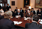 United States President Ronald Reagan meets with John Fisher, President, American Security Council and Executive Chairman, Coalition of Peace Through Strength, left, and other representatives of chief organizations in the coalition. The meeting took place in the Roosevelt Room in the White House in Washington, D.C. on Monday, March 7, 1983..Mandatory Credit: Karl Schumacher - White House via CNP