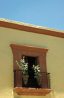 Flowers on the balcony of a restored Spanish colonial house in the city of Oaxac, Mexico