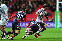 Anthony Watson of Bath Rugby takes on the Bristol Rugby defence. European Rugby Challenge Cup match, between Bristol Rugby and Bath Rugby on January 13, 2017 at Ashton Gate Stadium in Bristol, England. Photo by: Patrick Khachfe / Onside Images