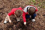 Both of my sons, then ages two and five, stop mid-hike to dig in the dirt at Lincoln Memorial Gardens in Springfield, Ill.