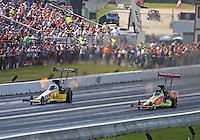 Jun 6, 2016; Epping , NH, USA; NHRA top fuel driver Shawn Langdon (left) races alongside J.R. Todd during the New England Nationals at New England Dragway. Mandatory Credit: Mark J. Rebilas-USA TODAY Sports
