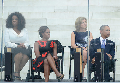 From left to right: Oprah Winfrey, first lady Michelle Obama, Ambassador Caroline Kennedy, and United States President Barack Obama listen as former U.S. President Bill Clinton (not pictured) makes remarks at the Let Freedom Ring ceremony on the steps of the Lincoln Memorial to commemorate the 50th Anniversary of the March on Washington for Jobs and Freedom<br /> Credit: Ron Sachs / CNP