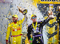 Sep 25, 2016; Madison, IL, USA; NHRA top fuel driver Shawn Langdon (left) and funny car driver Jack Beckman celebrate after winning the Midwest Nationals at Gateway Motorsports Park. Mandatory Credit: Mark J. Rebilas-USA TODAY Sports