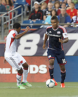 New England Revolution midfielder Juan Agudelo (10) dribbles at midfield.  In a Major League Soccer (MLS) match, the New England Revolution (blue) tied D.C. United (white), 0-0, at Gillette Stadium on June 8, 2013.