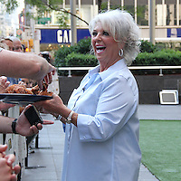 NEW YORK, NY - JULY 7:  Paula Deen celebrates National Fried Chicken Day at 'Fox and Friends' as she serves the audience some fried chicken in New York, New York on July 7, 2016.  Photo Credit: Rainmaker Photo/MediaPunch