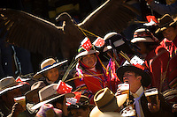 People drink as a wild condor is paraded around the village during the Yawar Fiesta in Coyllurqui in the Peruvian Andes on Independence Day. This celebration symbolises the clash between the indigenous people (represented by the condor) and the Spanish (represented by a bull). The condor is paraded around town, strapped on top of the bull, given alcohol, and finally set free.