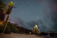 Night shots on the beach at Anibare district. Coral pinnacles such as these ones are broken down into pebbles to be used as building material for foundations, especially in the Pacific region. This is part of the secondary mining on Nauru...Nauru, officially the Republic of Nauru is an island nation in Micronesia in the South Pacific.  Nauru was declared independent in 1968 and it is the world's smallest independent republic, covering just 21square kilometers..Nauru is a phosphate rock island and its economy depends almost entirely on the phosphate deposits that originate from the droppings of sea birds. Following its exploitation it briefly boasted the highest per-capita income enjoyed by any sovereign state in the world during the late 1960s and early 1970s..In the 1990s, when the phosphate reserves were partly exhausted the government resorted to unusual measures. Nauru briefly became a tax haven and illegal money laundering centre. From 2001 to 2008, it accepted aid from the Australian government in exchange for housing a Nauru detention centre, with refugees from various countries including Afghanistan and Iraq..Most necessities are imported on the island..Nauru has parliamentary system of government. It had 17 changes of administration between 1989 and 2003. In December 2007, former weight lifting medallist Marcus Stephen became the President.