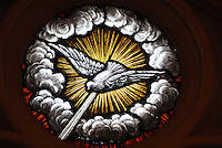 Stained glass image depicts the Holy Spirit. (Sam Lucero photo)