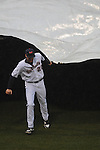 Ole Miss' Matt Crouse (20) rolls out the tarp in the second inning at Oxford University Stadium in Oxford, Miss. on Wednesday, February 23, 2011.