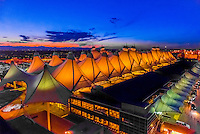 The Jeppesen Terminal, Denver International Airport, Denver, Colorado USA (with the Rocky Mountains on the left). The tent like roof is meant to resemble snow-capped mountains.